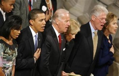 U.S. President Barack Obama, his wife Michelle, Vice President Joe Biden and his wife Jill, and former U.S. President Bill Clinton and Hillary Clinton sing the national anthem during the Presidential inaugural prayer service at the National Cathedral in Washington January 21, 2009. (Kevin Lamarque/Reuters)
