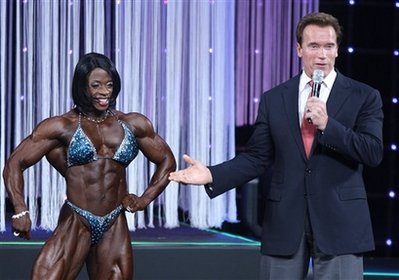 California Gov. Arnold Schwarzenegger congratulates Iris Kyle after she won the Miss International body building competition during the Arnold Sports Festival Friday, March 6, 2009, in Columbus, Ohio. (AP Photo/Jay LaPrete)