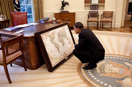 President Barack Obama looks at a map donated to the White House by the National Geographic Society, in the Oval Office, June 10, 2009. (Official White House Photo by Pete Souza)