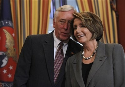 House Speaker Nancy Pelosi of Calif. huddles with House Majority Leader Steny Hoyer of Md. during a news conference on Capitol Hill