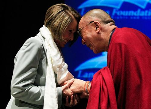 WASHINGTON - OCTOBER 06: The Dalai Lama (R) presents House Speaker Nancy Pelosi (D-CA) (L) with a Khata during a ceremony at the U.S. Capitol on October 6, 2009 in Washington, DC. The Lantos Foundation for Human Rights and Justice hosted the ceremony to honor the Dalai Lama as the first recipient of the Lantos Human Rights Prize.