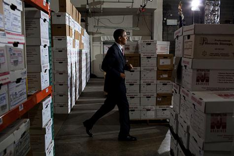 President Barack Obama jogs past boxes on his way to deliver remarks during a Small Business Administration event at the Metropolitan Archives in Hyattsville, Md., Oct. 21, 2009. (Official White House Photo by Pete Souza)