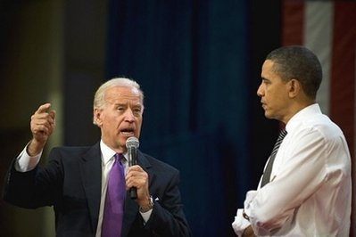 US President Barack Obama (R) and Vice President Joe Biden (L) speak during a town hall meeting at the University of Tampa in Tampa, Florida. Obama Thursday rekindled the 'Yes We Can' mood of his 2008 campaign, vowing not to shirk from the 'tough stuff' after his reform plans ground to a near halt in Congress. (AFP/Jim Watson)