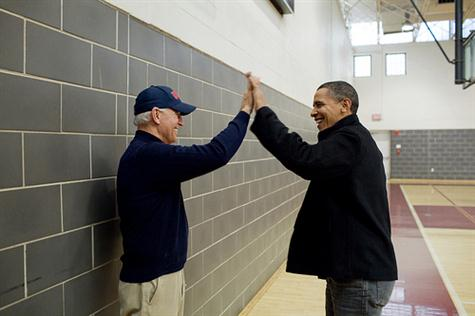 President Barack Obama and Vice President Joe Biden high-five after watching Sasha Obama and Maisy Biden, the Vice President's granddaughter, play in a basketball game in Chevy Chase, Md., Feb. 27, 2010. (Official White House Photo by Pete Souza)