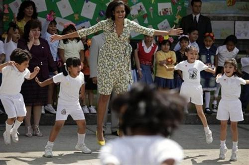First Lady Michelle Obama jumps as she dances with school children at the Siete de Enero school located in a low income neighborhood in Mexico City, Wednesday, April 14, 2010. Mrs. Obama is on a three-day visit to Mexico. (AP)