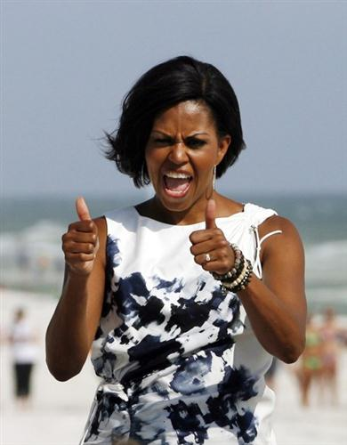 Michelle Obama poses for photos on a trip to Panama City Beach, Florida