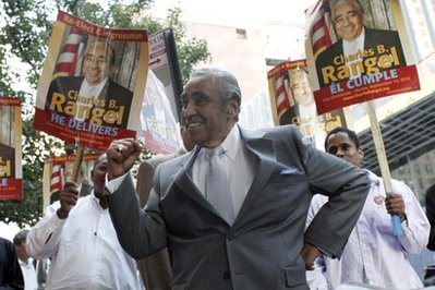 Congressman Charles Rangel pumps his fist while surrounded by supporters after attending a debate sponsored by the League of Women Voters, Thursday, Aug. 26, 2010 in New York.