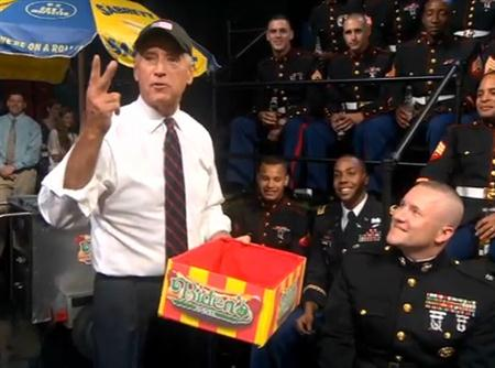Vice President Joe Biden hands out hotdogs to the troops during an appearance on the 'Colbert Report,' Wednesday, Sept. 8, 2010