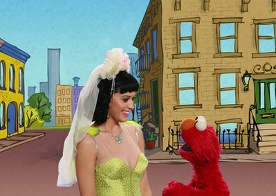 In this publicity image released by Sesame Workshop, singer Katy Perry, left, is shown with Elmo performing in a music video called 'Hot and Cold' about opposites on 'Sesame Street.' The children's show says it won't air a taped segment featuring the 'California Gurls' singer. The pop star -- who is known for her risque outfits -- wore a gold bustier top as she sang a version of her hit 'Hot N Cold.' But some felt it was too revealing for the kid set. (AP Photo/Sesame Workshop)