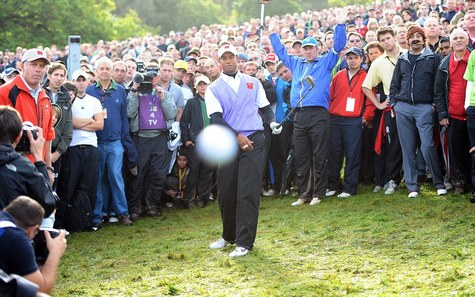 Tiger Woods hits a shot at the Ryder Cup challenge that was right on line... to a photographer's lens