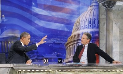 President Barack Obama gestures during a commercial break as he talks with host Jon Stewart as he takes part in a taping of Comedy Central's The Daily Show with Jon Stewart, Wednesday, Oct. 27, 2010, in Washington. (AP Photo/Charles Dharapak)