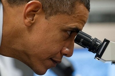 US President Barack Obama looks through a microscope as he tours a biotech classroom at Forsyth Technical Community College in Winston-Salem, North Carolina. Obama urged Monday a refocus on scientific research and teaching, as was triggered by the launch of the Soviet's 1957 Sputnik satellite, saying it was key to future US prosperity. (AFP/Saul Loeb)