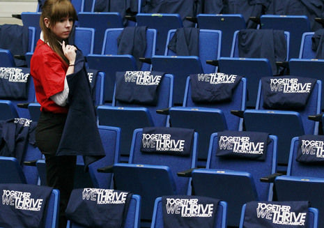 T-shirts are placed on chairs for a memorial service for victims of the January 8 shooting at the University of Arizona in Tucson, Arizona January 12, 2011.