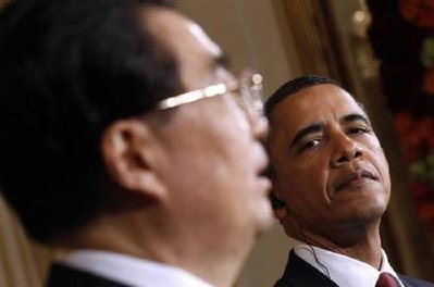 U.S. President Barack Obama looks on as Chinese President Hu Jintao speaks during a joint press conference in the East Room at the White House in Washington, January 19, 2011. REUTERS/Kevin Lamarque/Files