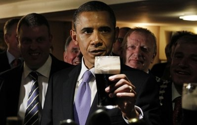 U.S. President Barack Obama drinks a Guinness beer as he meets with local residents at Ollie Hayes pub in Moneygall, Ireland, the ancestral homeland of his great-great-great grandfather, Monday, May 23, 2011. (AP Photo/Charles Dharapak)