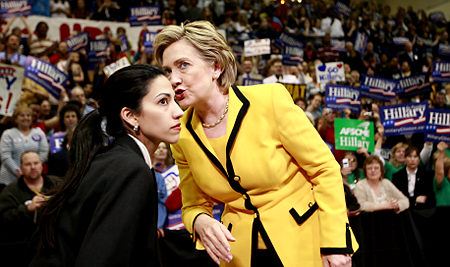 Anthony Weiner's wife, Huma Abedin talks with Hillary Clinton