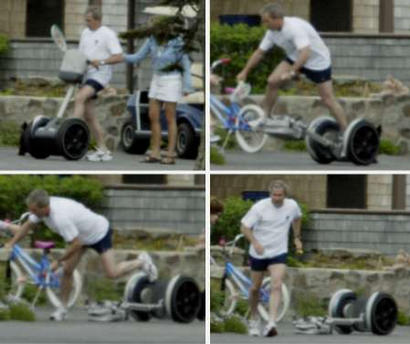President Bush falling off a Segway personal transporter on the front driveway of his parents' summer home June 12, 2003 in Kennebunkport, Maine.