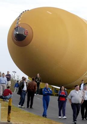 The redesigned shuttle fuel tank is transported to a barge in New Orleans, Friday morning Dec. 31, 2004. The redesigned fuel tank, a massive vessel that supplies propellant for the launch of the space shuttle, is beginning a barge trip across the Gulf of Mexico to the launch site on Florida's east coast. (AP Photo/Bill Haber)