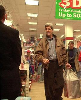 Democratic presidential hopeful U.S. Sen., John Kerry of Massachusetts leaves a toy store at the Mall of New Hampshire in Manchester, N.H., Friday, Nov., 28, 2003. Kerry bought and donated toys to the U.S. Marines Toys for Tots program. (AP Photo/Jim Cole)