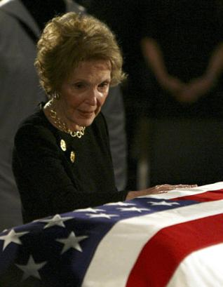 Former first lady Nancy Reagan pauses at the casket of her husband, former President Ronald Reagan on Capitol Hill Wednesday, June 9, 2004. (AP Photo/Ron Edmonds)