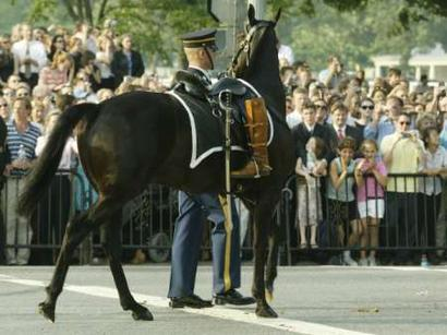 A riderless horse with the riding boots of former U.S. President Ronald Reagan is led behind a procession of the casket containing the body of the former president en route to the U.S. Capitol, June 9, 2004. Reagan's body will lie in state in the Capitol Rotunda until Friday when his funeral will be held at Washington's National Cathedral. REUTERS/Mike Segar