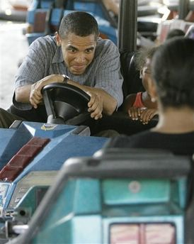 Democratic presidential hopeful U.S. Sen. Barack Obama D-Ill., and his daughter Sasha ride bumper cars at the Iowa State Fair Thursday, Aug. 16, 2007, in Des Moine,Iowa. (AP Photo/M. Spencer Green)