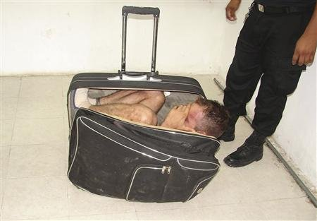 Handout photo shows an inmate hiding in a suitcase during an escape attempt from a prison in Chetumal