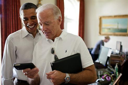 Vice President Joe Biden and President Barack Obama look at an app on an iPhone in the Outer Oval Office, Saturday, July 16, 2011. (Official White House Photo by Pete Souza)