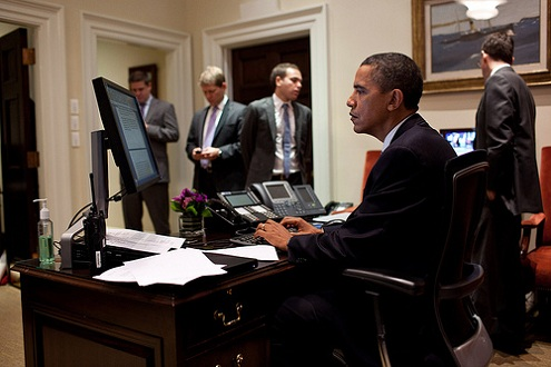 President Barack Obama works on his statement on the compromise reached to reduce the deficit and avert a default, in the Outer Oval Office, Aug. 2, 2011. Standing in the background are, from left: Director of Communications Dan Pfeiffer; Press Secretary Jay Carney; Jon Lovett, Associate Director of Speechwriting; and Senior Advisor David Plouffe. (Official White House Photo by Pete Souza)