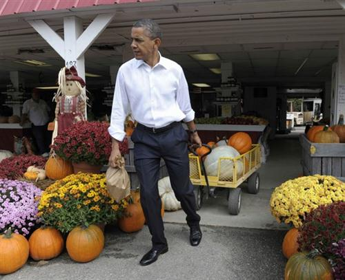 President Barack Obama stops to buy pumpkins at Wood's Orchard in Hampton, Va, Wednesday, Oct. 19, 2011. Obama is on a three-day bus tour promoting the American Jobs Act. (AP Photo/Susan Walsh)