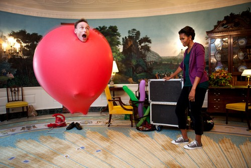 Guinness Book of World Records holder John Cassidy performs a balloon act for First Lady Michelle Obama in the Diplomatic Reception Room of the White House, Oct. 11, 2011. Cassidy performed for kids on the South Lawn before the First Lady launched a challenge to break the Guinness World Records title for the most people doing jumping jacks in a 24-hour period. (Official White House Photo by Chuck Kennedy)