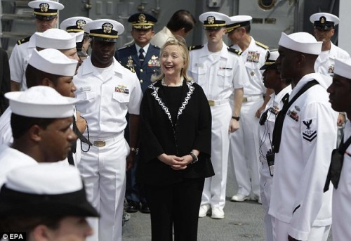 US Secretary of State Hillary Clinton leaves the USS Fitzgerald, a US Navy destroyer, docked at the Manila bay. Clinton has flown from the Philippines into Thailand to offer assistance in fighting massive floods, hoping to avoid a further crisis in a US ally torn by political infighting