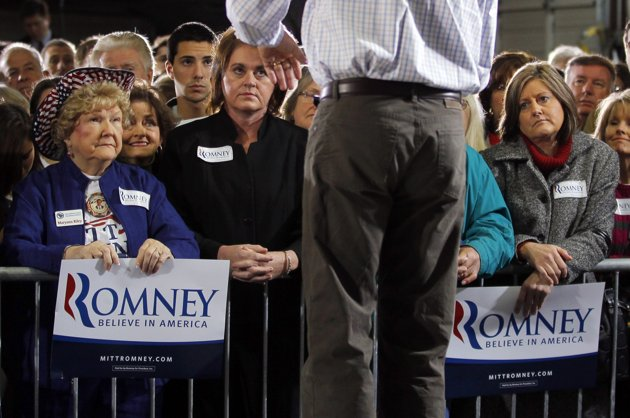 Audience members listen as Republican presidential candidate and former Massachusetts Governor Mitt Romney speaks during a campaign stop at Cherokee Trikes and More in Greer, South Carolina January 12, 2012. REUTERS/Brian Snyder