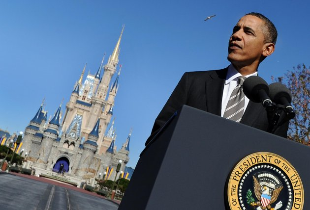 "US President Barack Obama speaks to a crowd of guests at Walt Disney World's Magic Kingdom with Cinderella Castle in the background, in Lake Buena Vista, Florida. Obama went to Disney World on Thursday touting a new jobs-from-tourism plan, but a top Republican rival mocked his trip as new evidence he lived in a political ""Fantasyland."" (AFP Photo/Jewel Samad)"