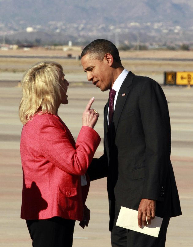 "Arizona Gov. Jan Brewer points during an intense conversation with President Barack Obama after he arrived at Phoenix-Mesa Gateway Airport, Wednesday, Jan. 25, 2012, in Mesa, Ariz. Asked moments later what the conversation was about, Brewer, a Republican, said: ""He was a little disturbed about my book."" Brewer recently published a book, ""Scorpions for Breakfast,"" something of a memoir of her years growing up and defends her signing of Arizona's controversial law cracking down on illegal immigrants, which Obama opposes. Obama was objecting to Brewer's description of a meeting he and Brewer had at the White House, where she described Obama as lecturing her. (AP Photo/Haraz N. Ghanbari)"