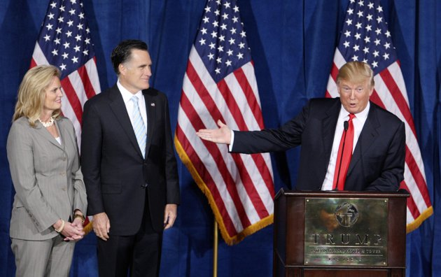 Republican presidential candidate and former Massachusetts Governor Mitt Romney (C) is endorsed by businessman and real estate developer Donald Trump at the Trump Hotel in Las Vegas, Nevada February 2, 2012. Ann Romney is at left. REUTERS/Steve Marcus