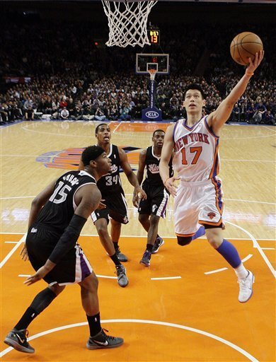 New York Knicks' Jeremy Lin (17) drives past Sacramento Kings' DeMarcus Cousins (15) during the second half of an NBA basketball game on Wednesday, Feb. 15, 2012, in New York. Lin had 10 points and 13 assists as the Knicks won the game 100-85. (AP Photo/Frank Franklin II)