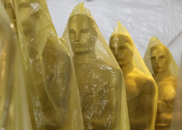 Oscar statues stand covered by plastic as preparations for the Oscars continue in Hollywood, California February 22, 2012. The 84th Academy Awards will take place on Sunday. REUTERS/Danny Moloshok (UNITED STATES - Tags: ENTERTAINMENT)
