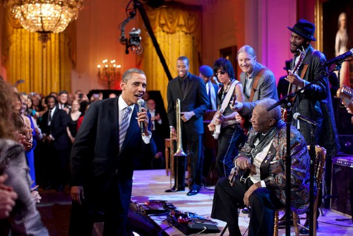 "President Obama joins in singing ""Sweet Home Chicago"" during the ""In Performance at the White House: Red, White and Blues"" concert in the East Room of the White House, Feb. 21, 2012. Participants include, from left: Troy ""Trombone Shorty"" Andrews, Jeff Beck, Derek Trucks, B.B. King, and Gary Clark, Jr. (Official White House Photo by Pete Souza)"