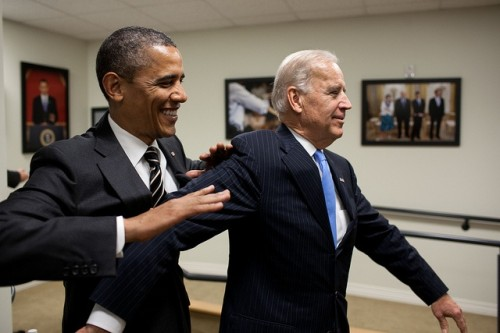 President Barack Obama jokes with Vice President Joe Biden backstage before the STOCK Act signing event in the Eisenhower Executive Office Building South Court Auditorium, April 4, 2012. (Official White House Photo by Pete Souza)