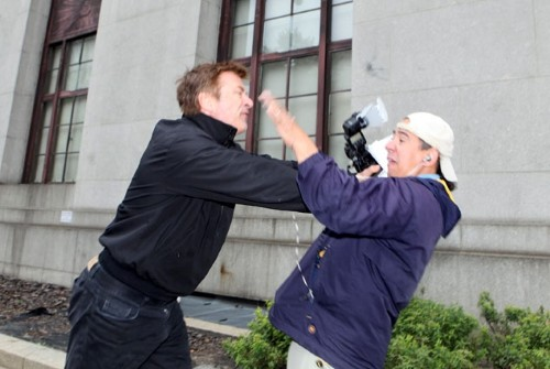 Alec Baldwin shoves Daily News photographer Marcus Santos after leaving the Marriage Bureau Tuesday morning.