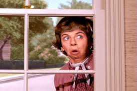 Gladys-Kravitz-nosy-neighbor-peeking-window