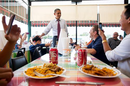 President Barack Obama talks with diners at Lechonera El Barrio restaurant while waiting for his lunch order during a stop in Orlando, Fla., Aug. 2, 2012. (Official White House Photo by Pete Souza)