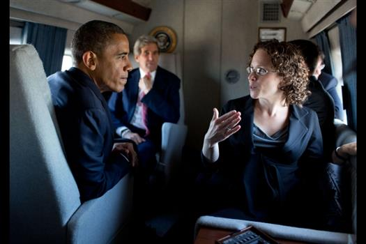 President Barack Obama talks with advisor Karen Dunn aboard Marine One en route from Camp David to Joint Base Andrews, Md., Oct. 22, 2012. Sen. John Kerry, D-Mass., is seen in the background. (Official White House Photo by Pete Souza)