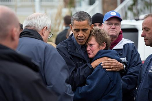 President Barack Obama hugs Donna Vanzant, the owner of North Point Marina, as he tours damage from Hurricane Sandy in Brigantine, N.J., Oct. 31, 2012. (Official White House Photo by Pete Souza)