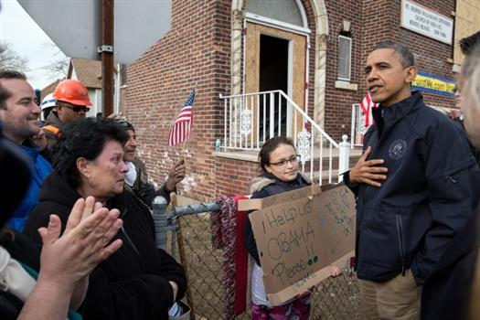 President Barack Obama talks with residents on Cedar Grove Avenue during a walking tour of Hurricane Sandy storm damage in Staten Island, N.Y., Nov. 15, 2012. (Official White House Photo by Pete Souza)