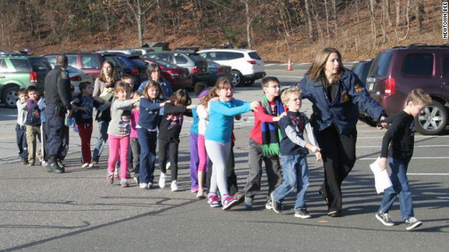 Children are lead away from the Sandy Hook Elementary School