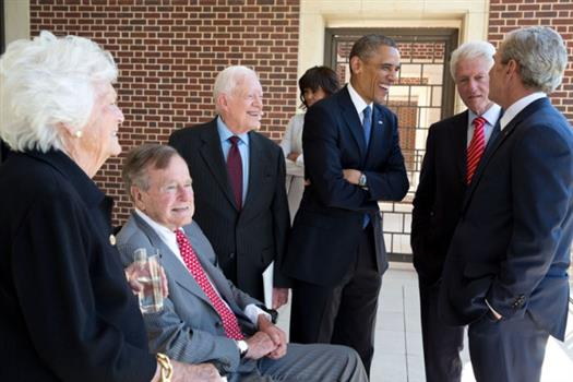 President Barack Obama talks with former Presidents George H.W. Bush, Jimmy Carter, Bill Clinton, George W. Bush, and former First Lady Barbara Bush at the opening of the George W. Bush Presidential Library and Museum in Dallas, Texas, April 25, 2013. First Lady Michelle Obama talks with an unidentified person in the background. (Official White House Photo by Pete Souza)
