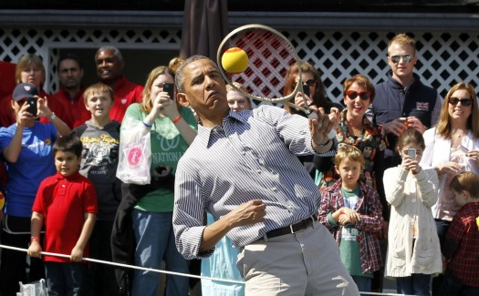 U.S. President Barack Obama plays tennis during the 135th annual Easter Egg Roll on the South Lawn of the White House in Washington, April 1, 2013. REUTERS/Jason Reed