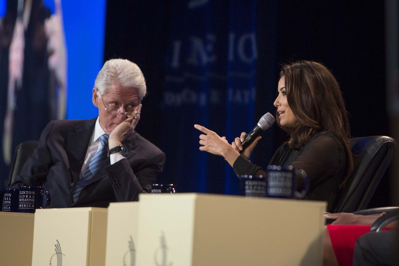 Former U.S. President Bill Clinton listens to Eva Longoria during a panel at the Clinton Global Initiative (CGI) meeting in Chicago, Thursday, June 13, 2013. During this opening session, Clinton was joined by other politicians and business leaders to discuss new ways to achieve economic and social mobility. (AP Photo/Scott Eisen)